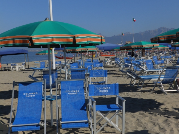 Rows and rows of deck chairs occupy the beaches. The hoi poloi (us) just get shingle.